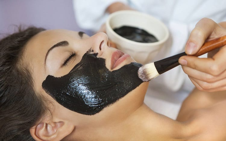Applying Activated Charcoal Face Mask