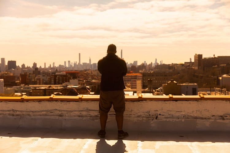 Man Standing On The Roof