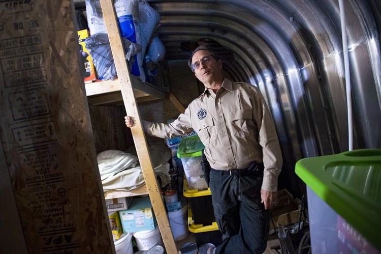 Man Showing Prepping Shelter