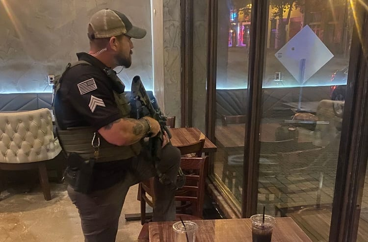 Armed Man Protecting Coffee Shop