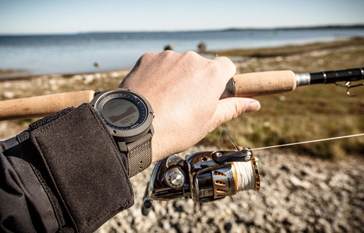 man fishing with survival watch