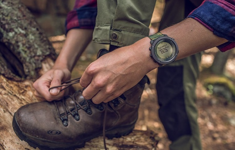 man tightens boots laces